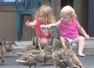 Miqaela and Melany feeding the ducks