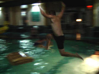 Jumping from the side of the pool.